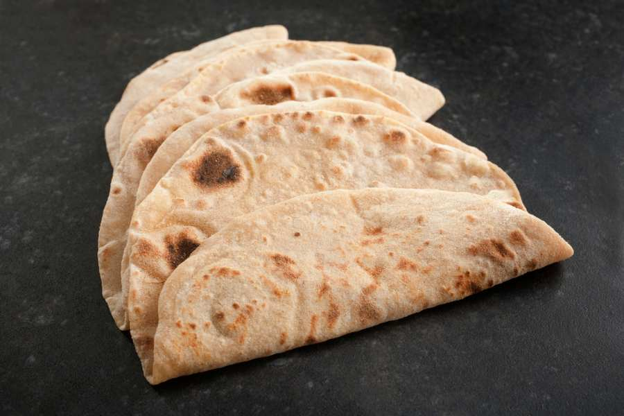 three chapatis on worktop