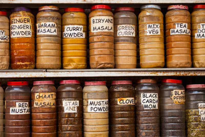 array of Indian spices in plastic pots